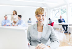 Businesswoman in a Office Working and Looking at Camera Stock Photos