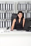 Businesswoman in ofice Stock Photography