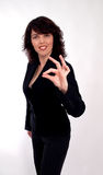 Businesswoman with OK gesture isolated Royalty Free Stock Image