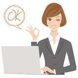 Businesswoman with OK pose Stock Photo