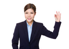 Businesswoman with ok sign gesture Royalty Free Stock Photos