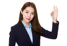 Businesswoman with ok sign gesture. Isolated on white background stock photos