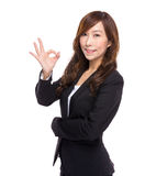 Businesswoman with ok sign Stock Photo