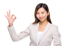 Businesswoman with ok sign Royalty Free Stock Photos