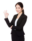 Businesswoman with ok sign Stock Photography