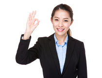 Businesswoman with ok sign Stock Images