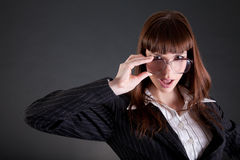 Businesswoman in old fashioned glasses Stock Image