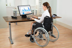 Businesswoman On Wheelchair Analyzing Graph Royalty Free Stock Photography