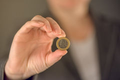 Businesswoman and one euro coin Royalty Free Stock Image