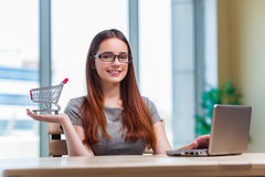 The businesswoman in online shopping concept Stock Images