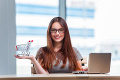 The businesswoman in online shopping concept Stock Image