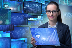 The businesswoman in online stock trading business concept Stock Images