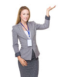 Businesswoman with open hand palm Stock Photo