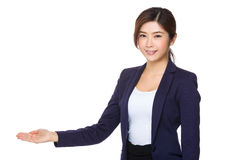 Businesswoman with open hand palm Royalty Free Stock Photo