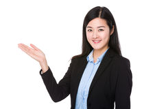 Businesswoman with open hand palm Stock Image