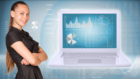 Businesswoman and open laptop with graphs Stock Images
