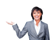 Businesswoman with open palm smiling at the camera Royalty Free Stock Photo