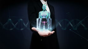 Businesswoman open palm, Zooming female body scanning womb, blue X-ray image. Businesswoman open palm, Zooming female body scanning womb stock video footage