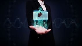 Businesswoman open palm, Zooming front body and scanning heart. Human cardiovascular system, Blue X-ray light. royalty free illustration