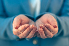 Businesswoman with open palms of her hands Stock Images