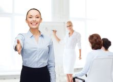 Businesswoman with opened hand ready for handshake Stock Images