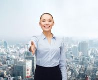 Businesswoman with opened hand ready for handshake Royalty Free Stock Photo
