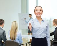 Businesswoman with opened hand ready for handshake Royalty Free Stock Image