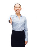 Businesswoman with opened hand ready for handshake Royalty Free Stock Photos