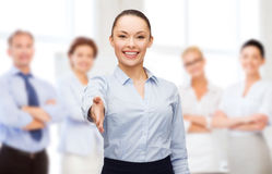 Businesswoman with opened hand ready for handshake Royalty Free Stock Images