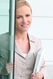 Businesswoman opening door Royalty Free Stock Photography