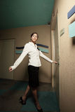Businesswoman opening a door Stock Images