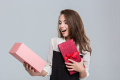 Businesswoman opening gift box Stock Photography