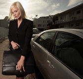 Businesswoman opening her briefcase Royalty Free Stock Photography