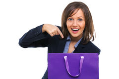 Businesswoman opening present Stock Photo