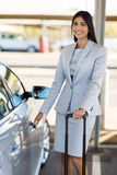 Businesswoman opens car door royalty free stock photo