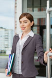Businesswoman opens door. Royalty Free Stock Images