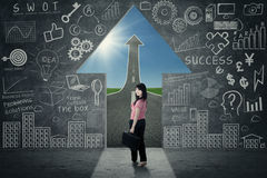 Businesswoman in opportunity door Royalty Free Stock Photography
