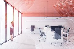 Businesswoman in orange ceiling office royalty free stock image
