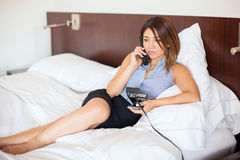 Businesswoman ordering room service in a hotel Royalty Free Stock Photo