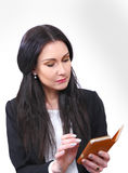 Businesswoman with organizor Stock Images