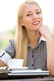 Businesswoman at outdoor cafe Royalty Free Stock Image