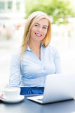 Businesswoman at outdoor cafe. Young businesswoman at outdoor cafe Royalty Free Stock Photography