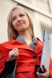 Businesswoman outdoors. Businesswoman with blue folder outdoors Royalty Free Stock Photography