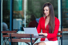 Businesswoman  in outdoors cafe. Beautiful brunette businesswoman  in outdoors cafe Stock Photos