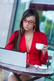 Businesswoman  in outdoors cafe. Beautiful brunette businesswoman  in outdoors cafe Stock Photo