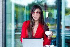 Businesswoman  in outdoors cafe. Beautiful brunette businesswoman  in outdoors cafe Royalty Free Stock Photos