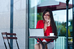 Businesswoman  in outdoors cafe. Beautiful brunette businesswoman  in outdoors cafe Stock Photography