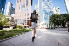 Businesswoman outdoors in the modern city Royalty Free Stock Photo