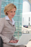 Businesswoman outside airport Royalty Free Stock Images