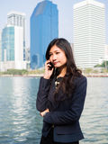 Businesswoman Outside Office On Mobile Phone Stock Image